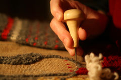 Rug Hooking. A traditional maritime craft Royalty Free Stock Images
