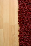 Rug on laminate floor Stock Image