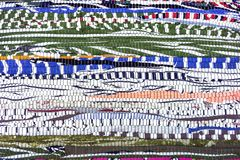 Rug of pieces of cloth. Texture and background of patchwork carpet.  royalty free stock photos