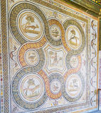 The rug of stone mosaic. TUNIS, TUNISIA - SEPTEMBER 2, 2015: The Bardo National Museum offers the great collection of the ancient art of stone mosaic producing Royalty Free Stock Photo