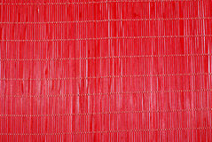 Rug for sushi. Bamboo rug of red colour for sushi Royalty Free Stock Photography