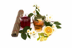 Rug, two mugs drinks and flower branch, still life, isolate Royalty Free Stock Image