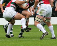 Rugby. Tackling in a game of rugby union Stock Image
