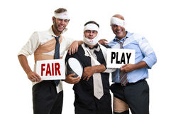 Rugby. Group of injured businessmen after a rugby game with the words Fair play Royalty Free Stock Image