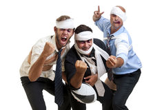 Rugby. Group of injured businessmen after a rugby game Royalty Free Stock Images