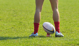 Rugby abstract. A rugby player's legs preparing to kick a rugby ball Royalty Free Stock Photography