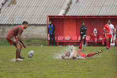 Rugby action on muddy field Stock Photo