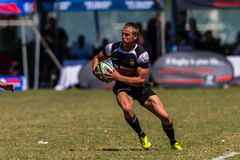 Player Ball Rugby Outeniqua. Rugby action of 1st teams high school players of mature young men between Greys College and Outeniqua Boys High School at the stock image