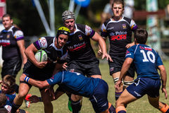 Player Ball Tackle Rugby Greys Outeniqua. Rugby action of 1st teams high school players  of mature young men between Greys College and Outeniqua Boys High School Stock Photos