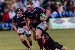 Player Forward Run Ball Rugby Westville. Rugby action of 1st teams high school players of mature young men between Greys College and Outeniqua Boys High School stock photos