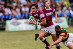 Player Centre Running Ball Rugby Kearsney. Rugby action of 1st teams high school players of mature young men between Greys College and Outeniqua Boys High School stock photos