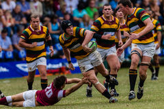 Forwards Passing Ball Rugby Paarl Gymn. Rugby action of 1st teams high school players of mature young men between Paarl Gymnasium and Kearsney Collegel at the royalty free stock photos