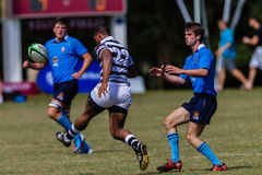Player Rugby Kicking Ball. Play moments of mature young men between Nico Malan High School and Selborne  College at the Kearsney easter rugby festival Stock Photos