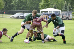 Rugby Action. Young male rugby players in action. 2013 State games of Michigan; June 22nd, 2013 at East Kentwood HS in Grand Rapids, MI Stock Photos