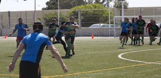 Rugby amateur. Amateur rugby match between ecija (blue) and Puerto Real (green stock photography
