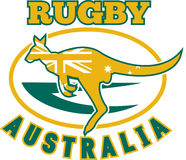 Rugby Australia kangaroo wallaby. Illustration of a kangaroo or wallaby jumping side view with australian flag inside silhouette  and rugby ball in background Stock Image