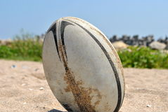 Rugby ball. Image of a rugby ball on the beach sand royalty free stock photo