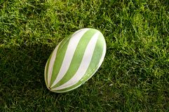 Rugby ball. On grass rugby pitch stock photo
