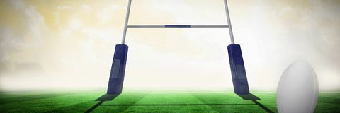 Composite image of rugby ball. Rugby ball against rugby pitch royalty free stock photography