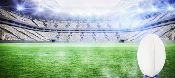 Composite image of rugby ball. Rugby ball against rugby stadium stock photos