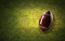 Rugby ball on grass Royalty Free Stock Image