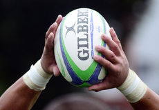 Rugby ball in hands. Rugby ball pictured in the hands of a player during the Romanian SuperLeague game between CSM Bucharest and Dinamo Bucharest stock image