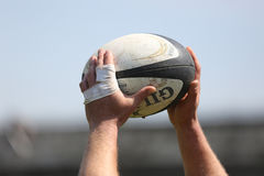 Rugby ball in hands. Rugby ball pictured in the hands of a player during the Romanian SuperLeague game between Dinamo Bucharest and CSM Bucharest stock photos