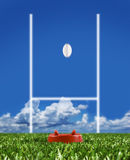 Rugby ball kicked to the posts showing movement. Rugby ball kicked to the posts on a rugby field showing movement Stock Photo