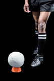 Rugby ball on kicking tee by sportsman Royalty Free Stock Image