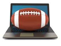 Rugby ball with laptop Stock Images