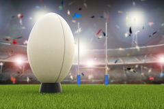 Rugby ball with rugby posts on field Stock Image