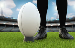 Rugby ball with rugby posts on field Royalty Free Stock Images