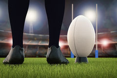 Rugby ball with rugby posts on field Royalty Free Stock Photo