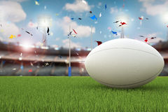 Rugby ball with rugby posts on field Stock Photography