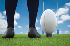Rugby ball with rugby posts on field Stock Photos