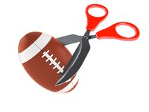 Rugby ball with scissors Stock Images