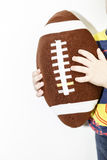 Rugby ball toy for children in boys hands with white background Royalty Free Stock Photography