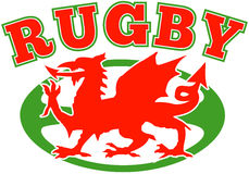 Rugby ball wales red dragon. Illustration of a red welsh wales dragon with rugby ball in background Royalty Free Stock Photography