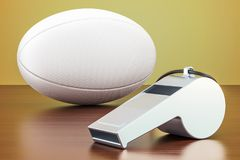 Rugby ball with whistle on the wooden table, 3D rendering. Rugby ball with whistle on the wooden table, 3D Royalty Free Stock Image