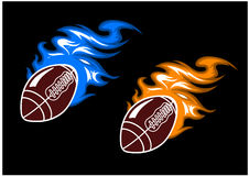 Rugby balls with colored fire flames Royalty Free Stock Photo