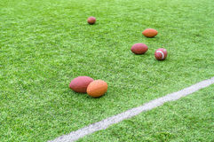 Rugby balls on field royalty free stock photos