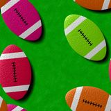 Rugby balls on a green pitch. Background with a rugby theme. Sports concept. Stock Image