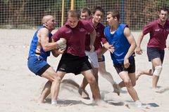Rugby beach tournamet. XII RUGBY BEACH TOURNAMENT, UKRAINE, KIEV – JUNE 18 : Rugby players in action at a XII Ukrainian National Rugby Beach Tournament on royalty free stock image