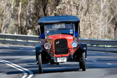 1925 Rugby F Tourer. Adelaide, Australia - September 25, 2016: Vintage 1925 Rugby F Tourer driving on country roads near the town of Birdwood, South Australia Stock Photos