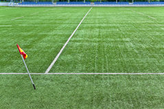 Sports field. Empty sports field with a flag near the white line markings royalty free stock images