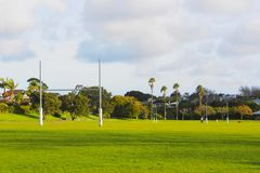 Rugby goal posts of field. Rugby field with padded goal posts Stock Photos