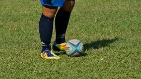 Rugby. Focus on player feet and ball. stock photography