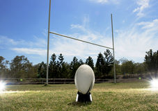 Rugby football positioned in front of the goal posts. Royalty Free Stock Images