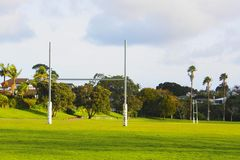 Rugby goal posts of field. Rugby field with padded goal posts Royalty Free Stock Image