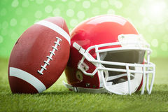 Rugby Helmet With Ball On Field Royalty Free Stock Photo